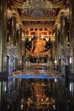 Golden buddha statue. In buddhist church Royalty Free Stock Photography