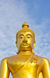Golden Buddha statue in a Buddhist temple Stock Images