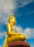 Golden Buddha statue against blue sky in a Buddhist temple Royalty Free Stock Photos