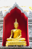 Golden Buddha statue in a Buddhist temple Royalty Free Stock Images