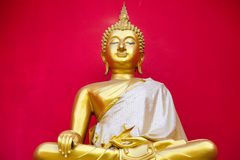 Golden Buddha statue in a Buddhist temple is red background Stock Images
