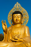 Golden Buddha statue at buddhist temple of Sanbanggulsa Royalty Free Stock Photography