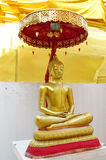 Golden Buddha statue in Buddhist temple Stock Images