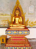 Golden Buddha statue in Buddhist temple stock photography