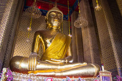 Golden Buddha statue in a Buddhist temple. Thailand Stock Photography