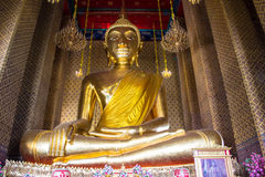 Golden Buddha statue in a Buddhist temple Royalty Free Stock Photo