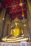 Golden Buddha statue in a Buddhist temple Royalty Free Stock Photography