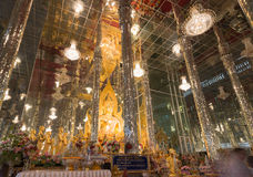Golden Buddha statue at Cathedral glass, Temple in Thailand Royalty Free Stock Images