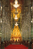Golden Buddha statue at Cathedral glass Royalty Free Stock Photo