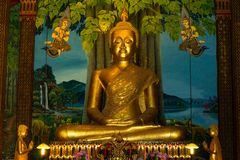 Golden Buddha statue in the chapel.  Royalty Free Stock Image
