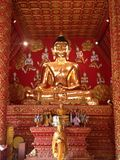 Golden Buddha statue. In church at Phra That Lampang Luang temple, Lampang province northern of Thailand Royalty Free Stock Image