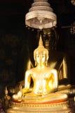 Golden Buddha statue in the church Stock Photos