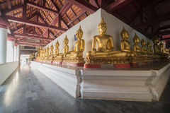 Golden Buddha statue. In the cloister Stock Photography