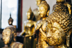 Golden Buddha Statue close-up. Stock Photography
