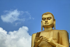 Golden Buddha Statue in Dambulla, Sri Lanka Royalty Free Stock Images