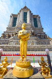 Golden buddha statue on the face of the temple walls Stock Photography