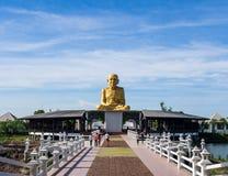 Golden Buddha statue. And footbridge Stock Image