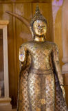 Golden buddha statue with the forbidding hand Stock Photos