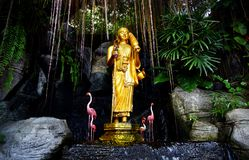 Golden Buddha statue in the garden Stock Photos