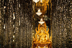 Golden Buddha Statue in Glass Hall Royalty Free Stock Photography
