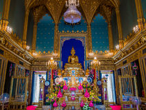 Golden Buddha statue in gothic style temple. Stock Image