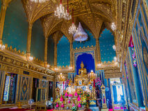 Golden Buddha statue in gothic style temple. Stock Photography