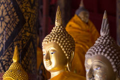 Golden Buddha Statue. Head close up with sun light and shadow Stock Image