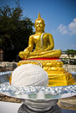 Golden buddha statue in a house construct ceremony event. With some fruit Royalty Free Stock Images