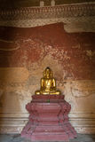 Golden Buddha statue inside a temple in Bagan Stock Images