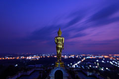 Golden buddha statue in Khao Noi temple at twilight royalty free stock images
