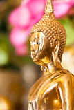 Golden Buddha statue Stock Images