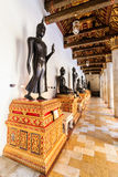Golden Buddha statue in the Marble Temple or Wat Benchamabophit Stock Photos