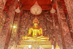 Golden Buddha. Statue meditating in the shade Stock Photography