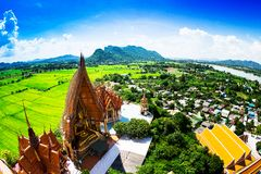Golden buddha statue with mountain, Wat Tham Sua(Tiger Cave Temp. Le), Tha Moung, Kanchanburi, Thailand Stock Photos