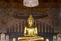 Golden buddha statue on mural background Royalty Free Stock Photo