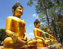 The golden Buddha statue on outdoor Stock Photo