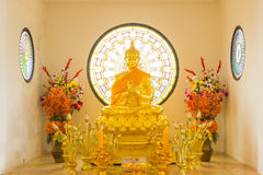 Golden buddha statue in peace Stock Photos
