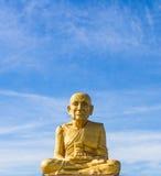Golden Buddha statue. Shining in the sun Royalty Free Stock Image
