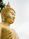 Golden buddha statue. Golden buddha statue side view Stock Image
