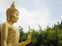 Golden buddha statue. Golden buddha statue with sky Stock Images