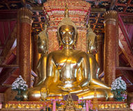 Golden Buddha statue is squat Stock Photo