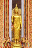 Golden buddha statue standing with garland Royalty Free Stock Photos