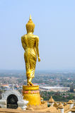 Golden Buddha statue standing on a mountain Stock Images