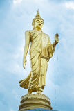 Golden Buddha statue standing In the park.Thailand. Golden Buddha statue standing In the park in Roi Et Province Thailand.Respected the Buddhist faith And the Royalty Free Stock Photo