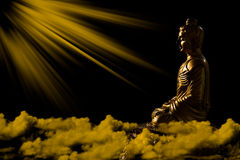 Golden Buddha Statue with Sunray Effect Stock Image