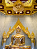 Golden Buddha statue in a temple. BANGKOK, THAILAND - JUL 18 : The Golden Buddha statue, Phra Budda Mahasuwana Patimakorn in the traditional pose Bhumisparsha Royalty Free Stock Photography
