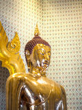 Golden Buddha statue in a temple. BANGKOK, THAILAND - JUL 18 : The Golden Buddha statue, Phra Budda Mahasuwana Patimakorn in the traditional pose Bhumisparsha Stock Photography