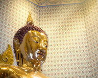 Golden Buddha statue in a temple. BANGKOK, THAILAND - JUL 18 : The Golden Buddha statue, Phra Budda Mahasuwana Patimakorn in the traditional pose Bhumisparsha Royalty Free Stock Photo