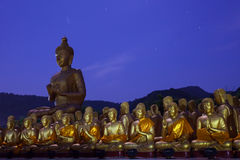 Golden buddha statue in temple with beautiful with star tail aga Stock Photography