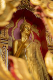 Golden Buddha statue in temple Stock Photo